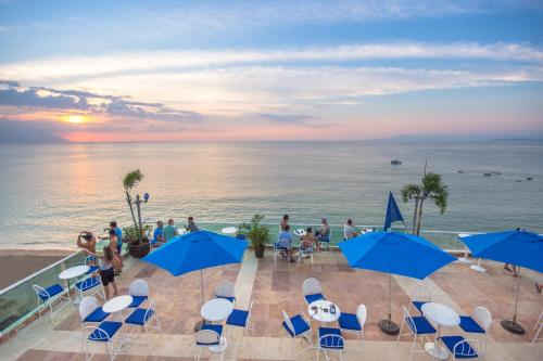 Blue Chairs Resort by the Sea Photo