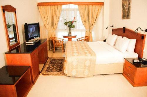 Ramee Guestline Hotel Apartment 3 Photo