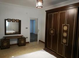 Three-Bedroom Apartment in Mohandseen, Kair