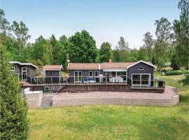 Four-Bedroom Holiday Home in Boxholm, Blåvik