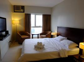 Goldland Millenia Suites by Stays PH, Manila