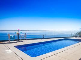 Eden Sun - A Modern Luxury Villa with a Panoramic View, Estreito da Calheta