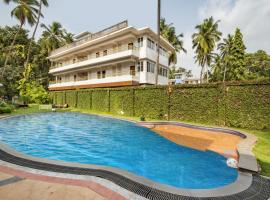 Apartment with a pool in Arpora, Goa, by GuestHouser 31843, Arpora