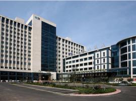 Qingdao Blue Horizon Hotel - Licang, Циндао