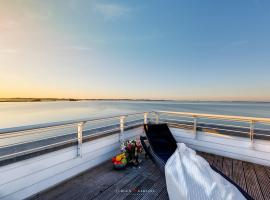 Ostseewind: Wasserblick, finnische Sauna, Whirlwanne, Kamin, 2 Parkplaetze