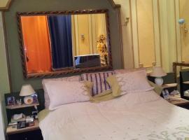Charming Three-Bedroom Apartment at Abdelkhalek Sarwat Street, Каир