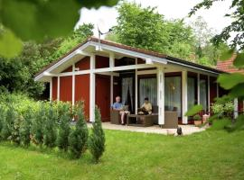 Single storey detached bungalow, located in a wooded area