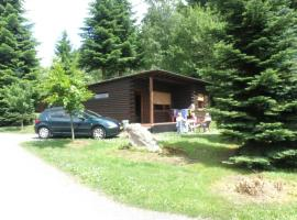 Tidy furnished wooden chalet, located close to the forest