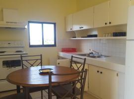 Plumeria Apartments, Garapan