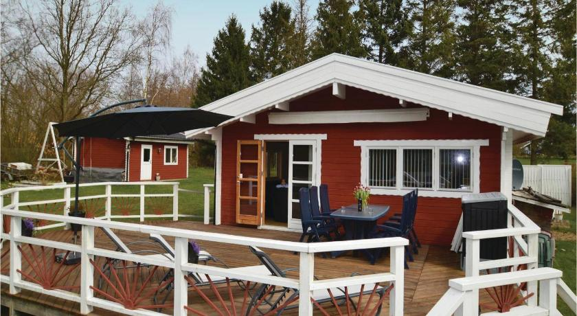 Exterior view Three-Bedroom Holiday home Bogø By with a Fireplace 09