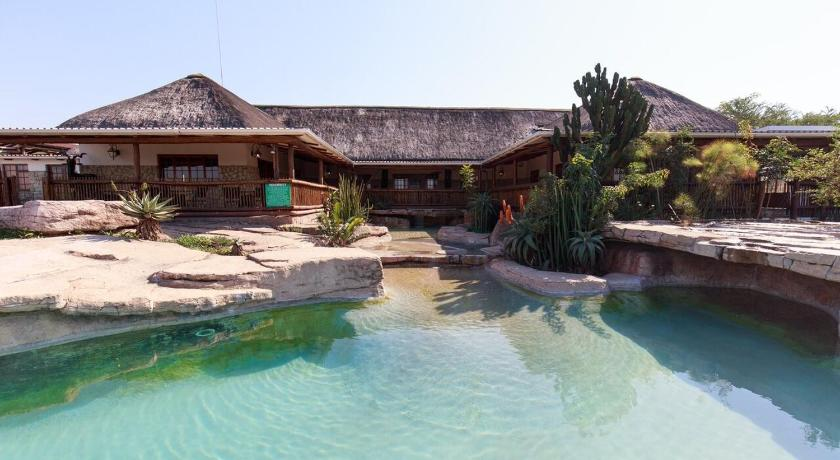Piscina Rain Farm Game Lodge