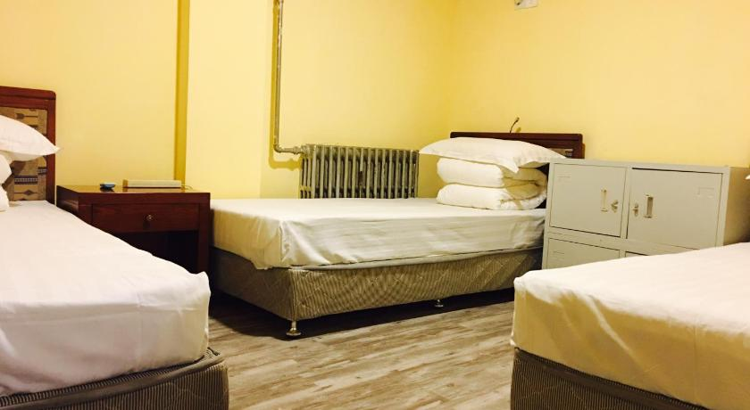 Bed in 3-Bed Male Dormitory Room without Window with Shared Bathroom - Δωμάτιο Beijing Gulou Riverside Youth Hostel