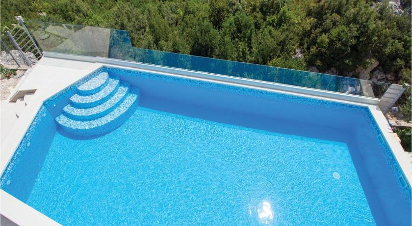 Schwimmbad Four-Bedroom Holiday home Kastel Novi with an Outdoor Swimming Pool 02