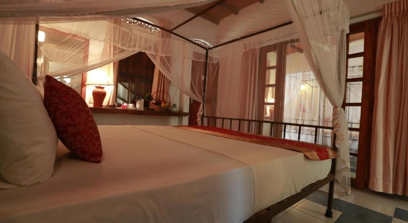 Standard Quadruple Room with Garden View - Llit Nooit Gedacht Heritage Hotel