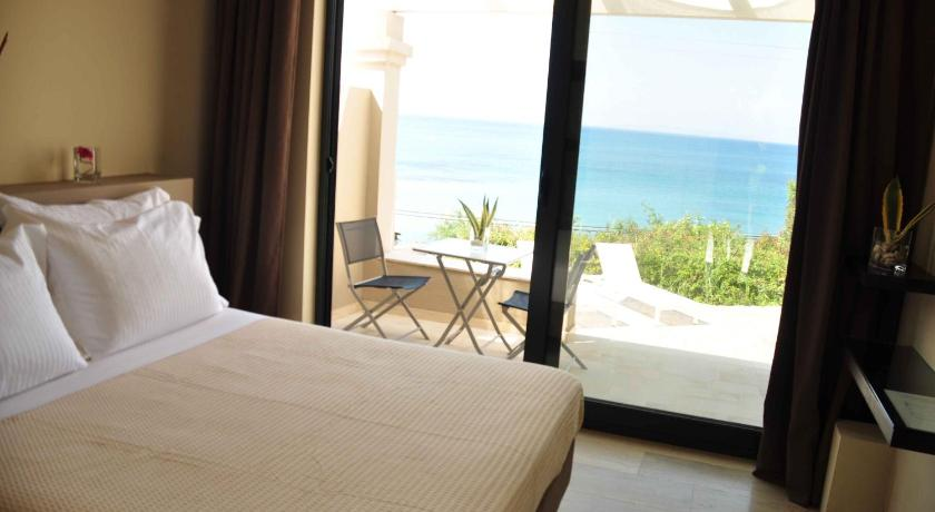 Studio mit Meerblick - Bett Palms and Spas Boutique Suites and Villas