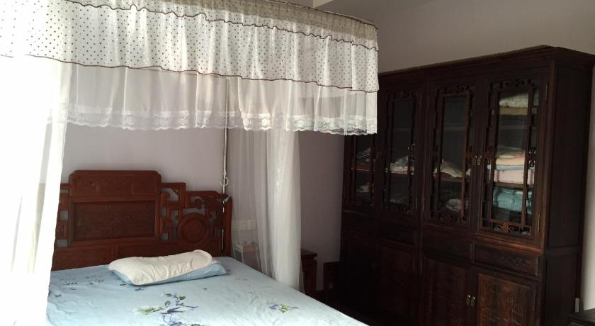 Double Room with Garden View - Bed Huaqiaocheng Villa