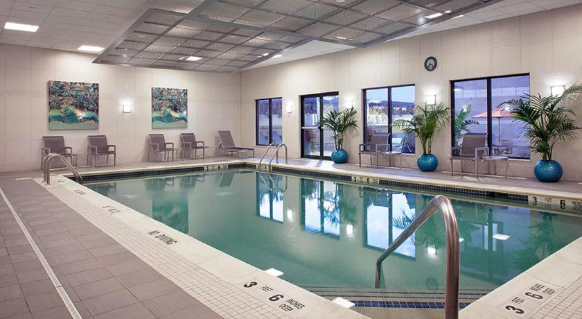 Pool Global Luxury Suites near the Metro-North Station