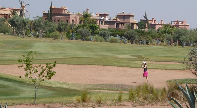 campo de golf en el alojamiento Villa Blanche - Samanah Golf Country Club