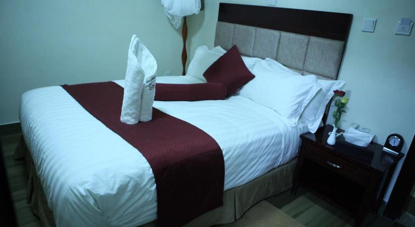 Budget Single Room - Bed Water Front Hotel