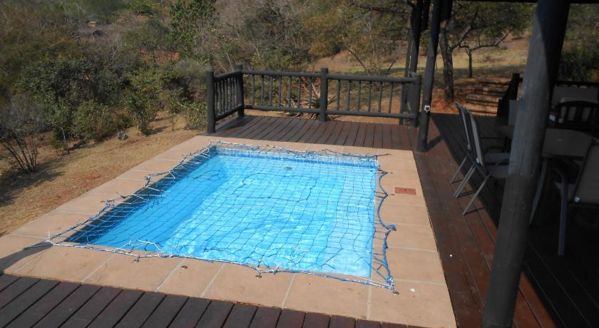 Swimmingpool DaGama Lake Cottages(Fire Thorn & Sycamore Cottages)