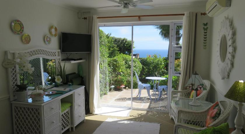 Deluxe Garden Studio with Partial Sea View Cape Rose Cottage