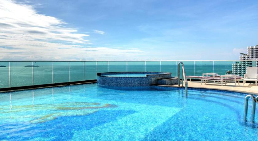 Swimming pool Cozy Beach View Condo by Homelicious Hospitality