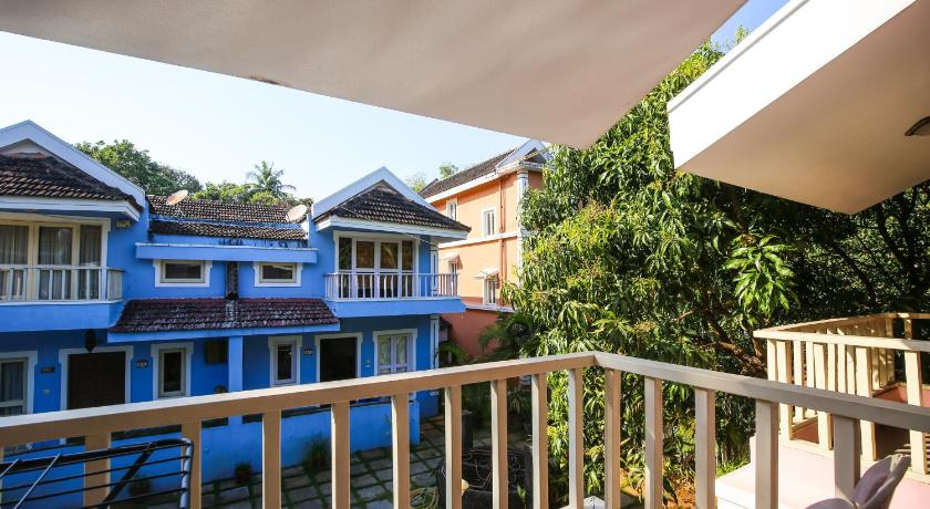 Studio with Pool View - Balcony/terrace Goan Courtyard Apartments