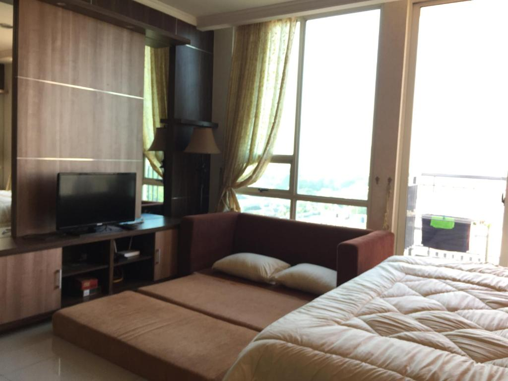 Appartement mit Balkon - Bett Peggy Apartemen Ancol Mansion