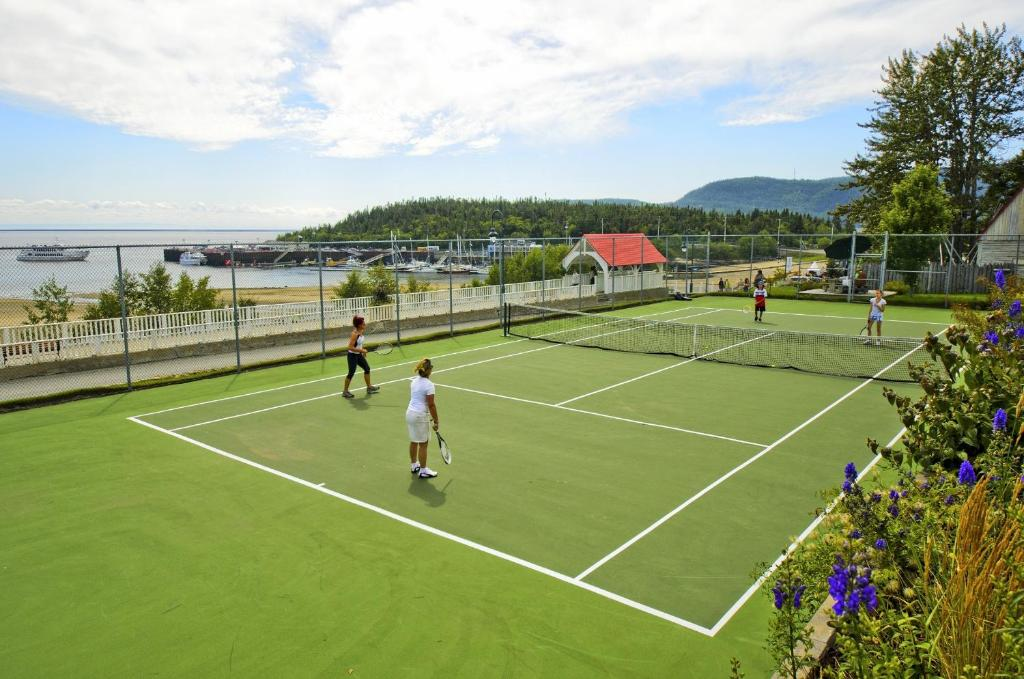 Book Now Hotel Tadoussac (Tadoussac, Canada). Rooms Available for all budgets. Overlooking Tadoussac Bay and the Saguenay Fjord this beautiful historic hotel features on-site spa services. Free WiFi and a choice of 2 restaurants are also available.A flat