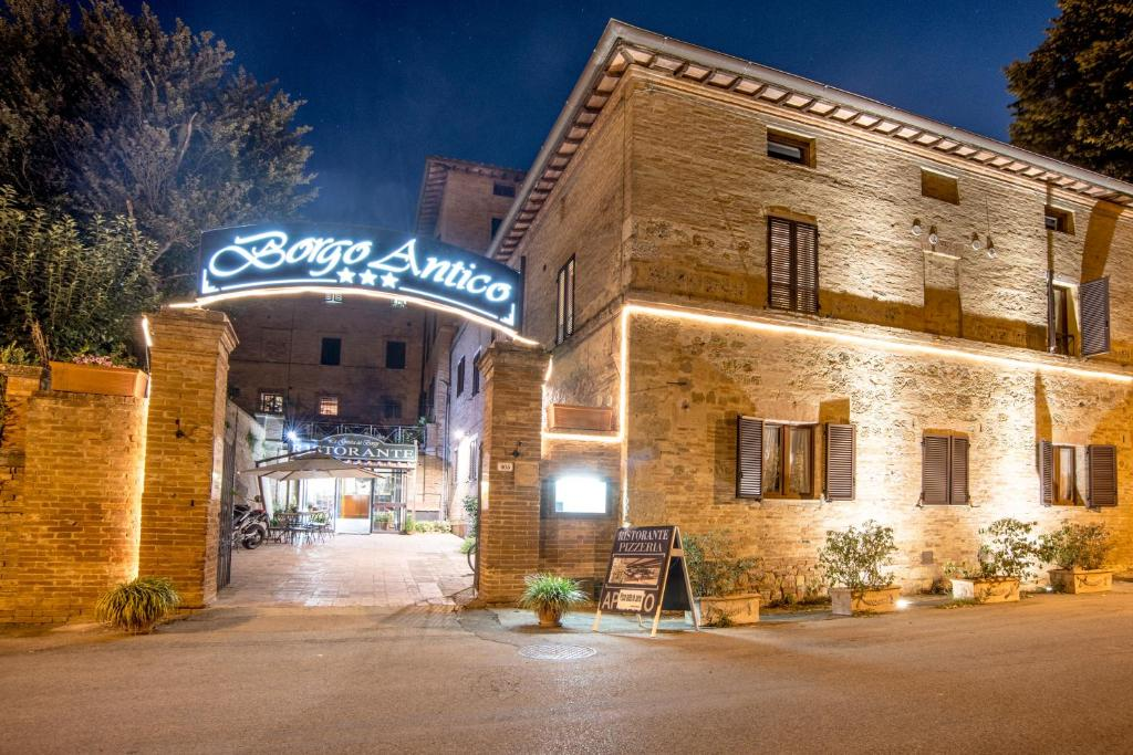 Book Now Hotel Borgo Antico (Monteroni d'Arbia, Italy). Rooms Available for all budgets. Situated in an ancient Medieval village in the heart of the Crete Senesi the hotel is ideally placed between Siena and Montalcino offering a calm and pleasant atmosphere in be
