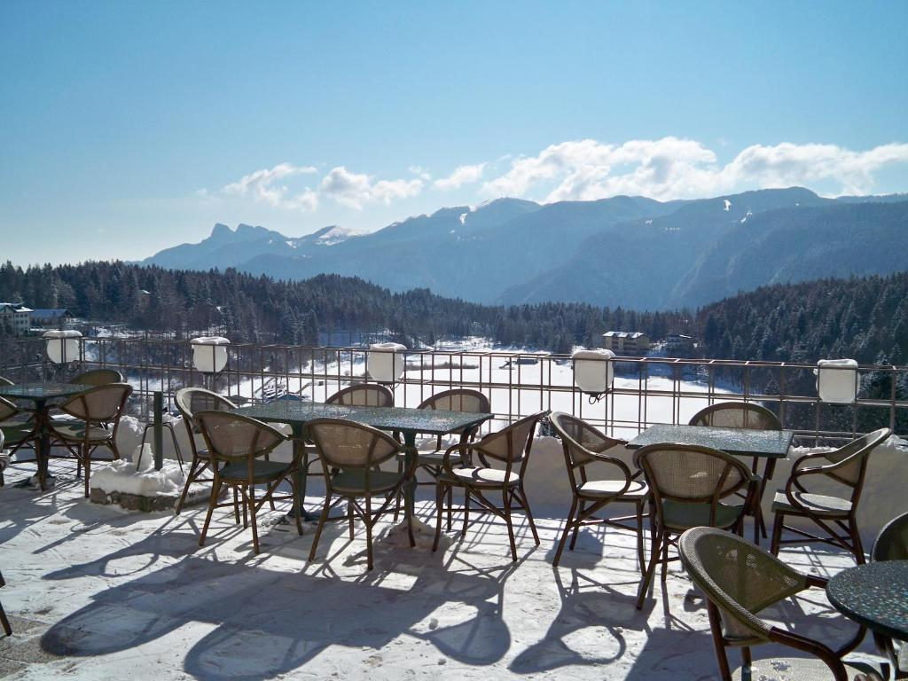 Book Now Grand Hotel Astoria (Lavarone, Italy). Rooms Available for all budgets. The Astoria offers a panoramic terrace overlooking the surrounding Alps and nearby Lavarone Lake just 500 metres away. Parking is free at the Grand Hotel and rooms are elegant
