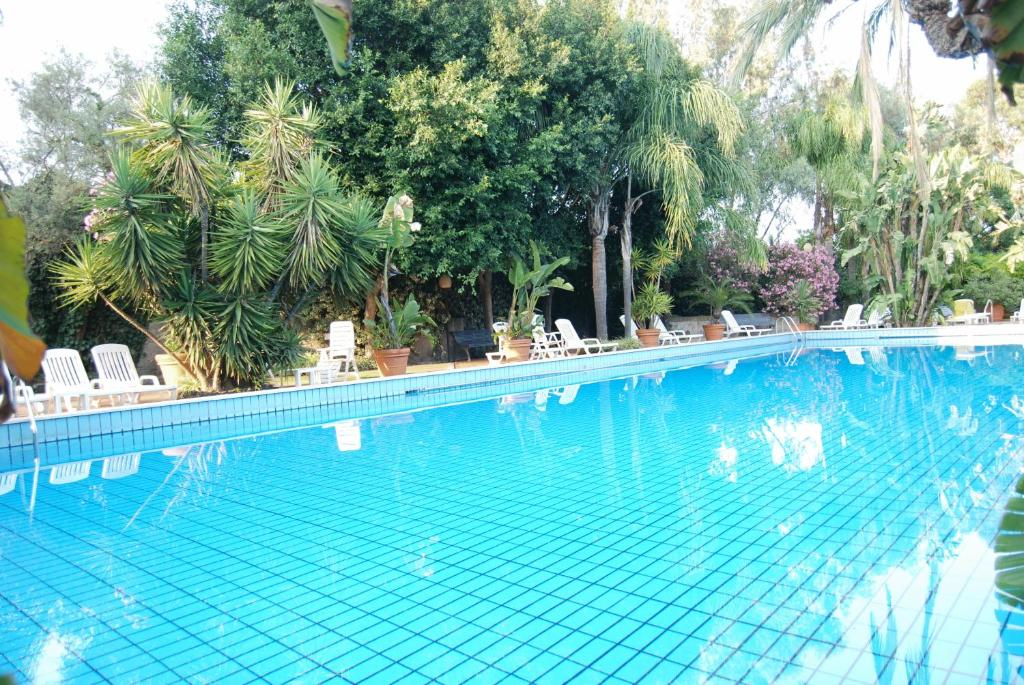 Book Now Garden Hotel (San Giovanni la Punta, Italy). Rooms Available for all budgets. Set in a peaceful location at the foot of Mount Etna and surrounded by a tranquil green park Hotel Garden features an outdoor swimming pool and free Wi-Fi. Located in San Giov
