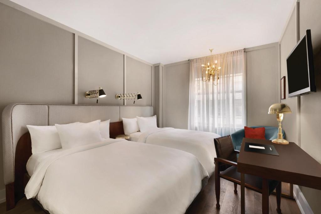 Book Now The Evelyn (New York City, United States). Rooms Available for all budgets. This Midtown Manhattan boutique hotel is north of Madison Square Park in the NoMad neighbourhood. Residential-inspired rooms offer Art Nouveau style and free WiFi.A flat-scree