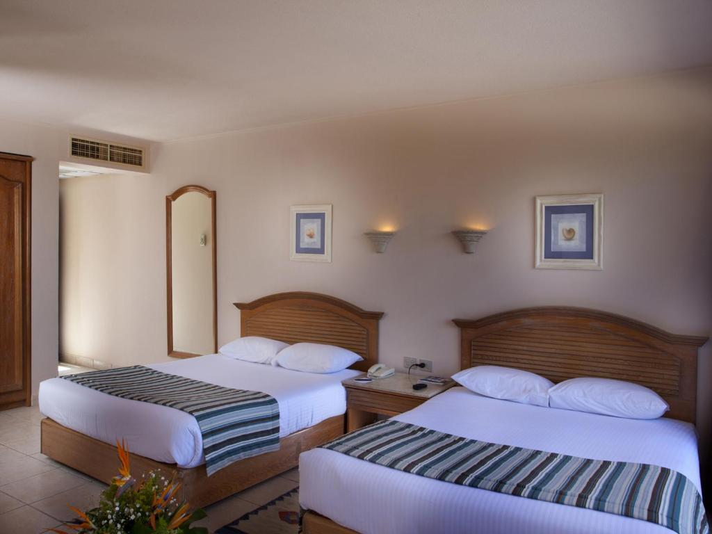 Triple Room with Sea View - Guestroom Hurghada Coral Beach Hotel (Ex. Rotana)