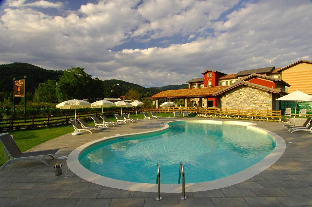 Book Now Hotel Cortese (Armeno, Italy). Rooms Available for all budgets. Encircled by expansive lush gardens and immersed in nature this brand new 4-star hotel lies in the small historical village of Armeno and fuses t