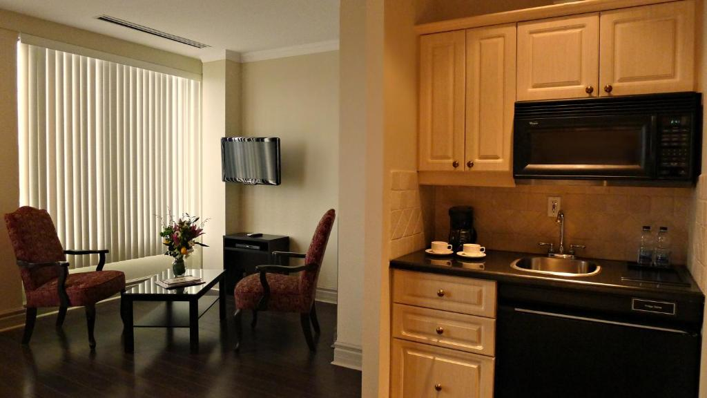Book Now Grand Hotel & Suites Toronto (Toronto, Canada). Rooms Available for all budgets. Kitchenettes rooftop views a spa and complimentary Wi-Fi sweeten the list of amenities at the Grand Hotel & Suites Toronto steps from Eaton Centre. Hardwood flooring kitchenet