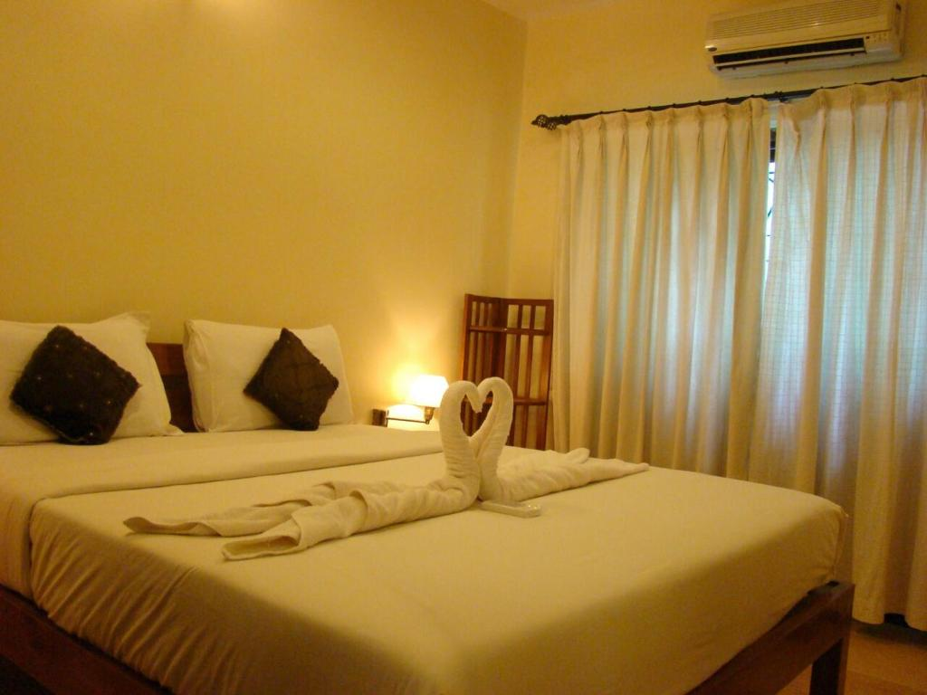 Kamar Super Deluxe Double - Ranjang The Retreat Resort