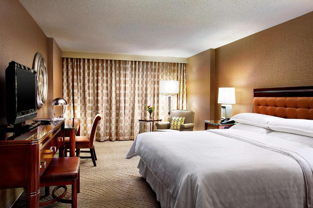 Book Now Sheraton Cavalier Hotel Saskatoon (Saskatoon, Canada). Rooms Available for all budgets. Turning guests on with a swank downtown address and free Wi-Fi the non-smoking Sheraton Cavalier Hotel Saskatoon lures with an indoor water park and dreamy riverfront views. T