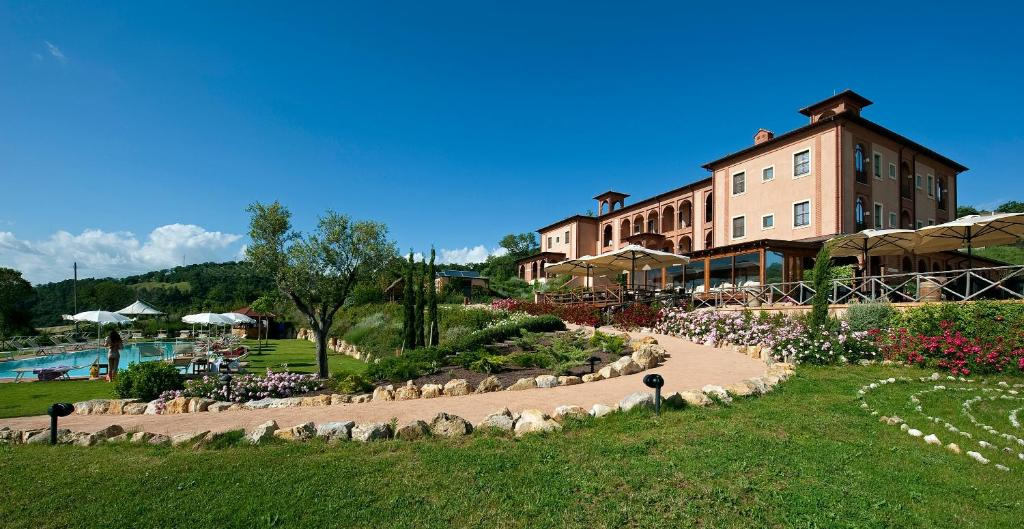 Book Now Saturnia Tuscany Hotel (Poggio Murella, Italy). Rooms Available for all budgets. This Tuscan villa designed by Paolo Portoghesi is immersed in the green landscape of the Tuscan hills and overlooks the Valley of Saturnia. It features a wellness centre and f