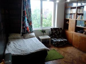 obrázek - Downtown Apartment Library