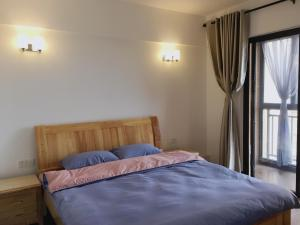 Lai Dou Zhen Seaview Apartment, Apartmanok  Tungsan - big - 5