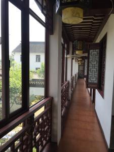 Suzhou Dongshan Xanadu Inn, Alloggi in famiglia  Suzhou - big - 8