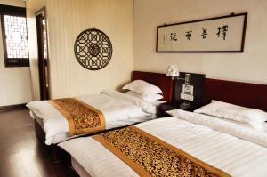 Suzhou Dongshan Xanadu Inn, Alloggi in famiglia  Suzhou - big - 12