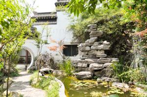 Suzhou Dongshan Xanadu Inn, Alloggi in famiglia  Suzhou - big - 18