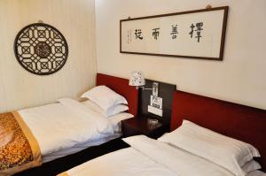 Suzhou Dongshan Xanadu Inn, Alloggi in famiglia  Suzhou - big - 21