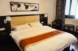 Suzhou Dongshan Xanadu Inn, Alloggi in famiglia  Suzhou - big - 24