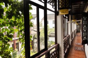 Suzhou Dongshan Xanadu Inn, Alloggi in famiglia  Suzhou - big - 37