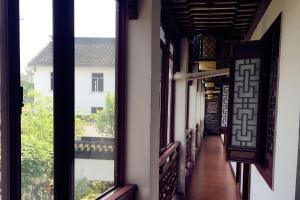 Suzhou Dongshan Xanadu Inn, Alloggi in famiglia  Suzhou - big - 43