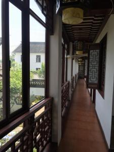 Suzhou Dongshan Xanadu Inn, Alloggi in famiglia  Suzhou - big - 56