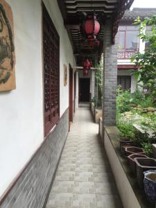Suzhou Dongshan Xanadu Inn, Alloggi in famiglia  Suzhou - big - 79